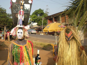 Two masquerades (Njenje and Okwebu) on the streets of Afikpo